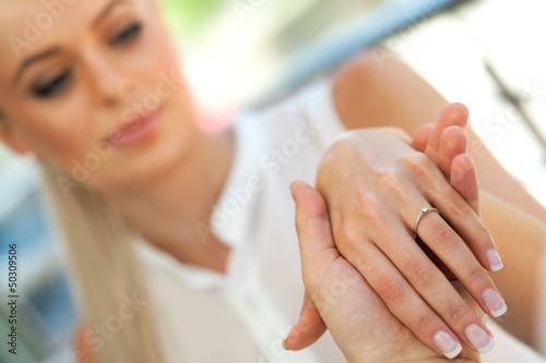 Extreme close up of girls hand with engagement ring.