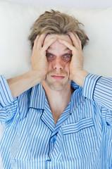 Stressed man can't sleep