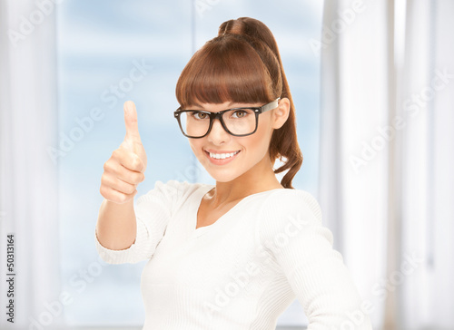 girl with thumbs up and glasses