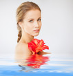 lovely woman with lily flower in water