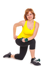 Happy middleaged woman exercising with dumbbells