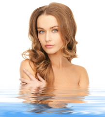 beautiful woman with long hair in water