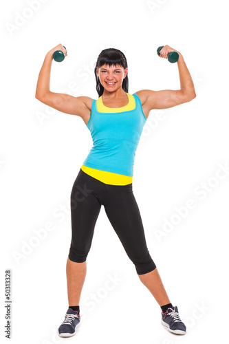 Young happy brunette exercising with dumbbells