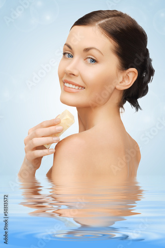 woman with soap in water