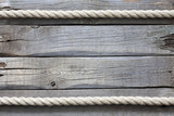Rope on old vintage wooden planks abstract background