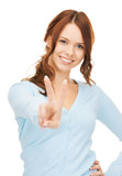 woman showing victory or peace sign