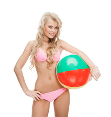 beautiful woman in bikini with beach ball