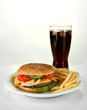 Tasty cheeseburger with fried potatoes and cold drink, isolated