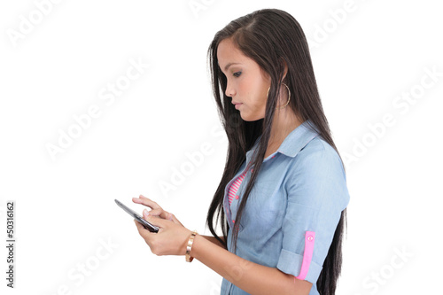 Brunette woman typing on her new electronic tablet touch pad com