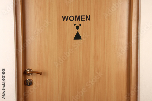 Toilet sign on wooden door