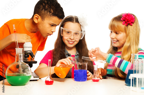 Three kids and chemistry lab