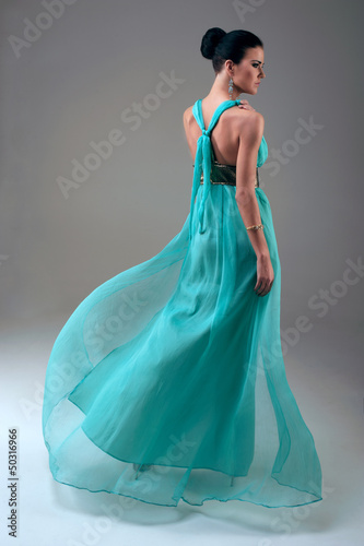 girl in a turquoise dress walking