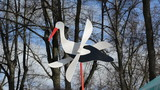 toy stork on shaft with wooden wings easily rotating in wind poster
