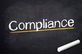 Kreidetafel mit Compliance poster