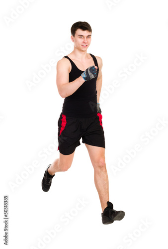 male athlete running isolated on white background
