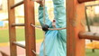 little child climbs in the playground, steady cam shoot