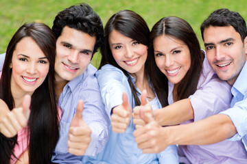 Group of friends with thumbs up