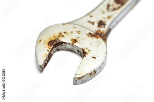 Isolated rusty spanner