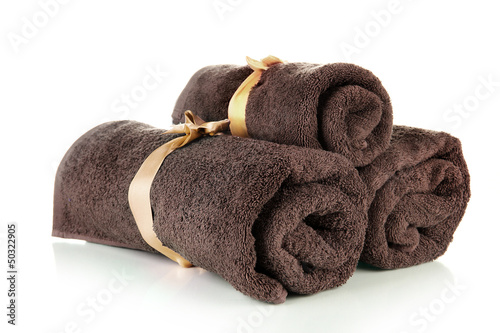 Three rolled towels, isolated on white
