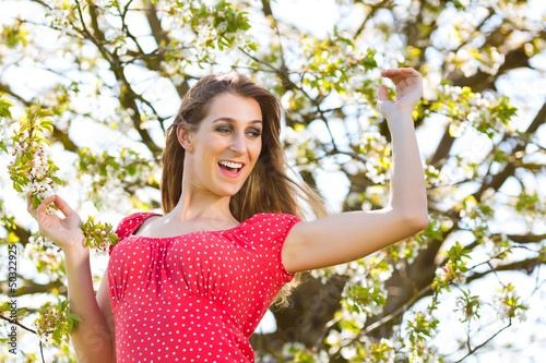 Girl in spring and tree blossom