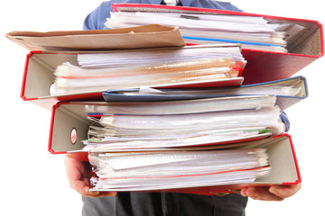 Male office worker carrying a stack of files