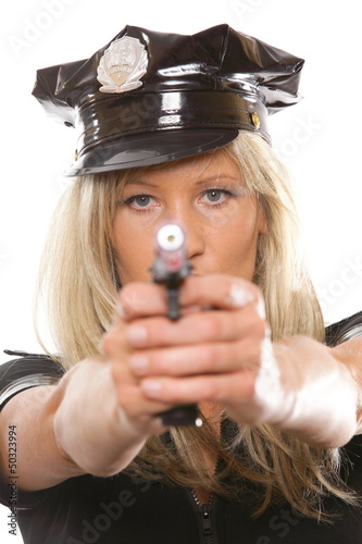 Portrait female police with gun isolated