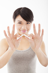 young woman breaking cigarette and stop smoking