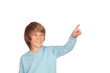 Happy preteen boy pointing something