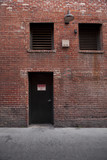 Alley Entrance backside of Brick Building