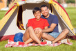 Young Couple Camping on Summer