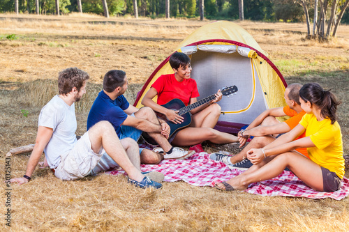 Group of People Camping and Singing