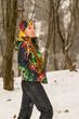 Beautiful woman in ski suit in snowy winter outdoors,Almaty