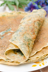 crepes with spinach closeup vertical