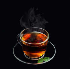 cup of black tea with mint and smoke on a black background © cook_inspire