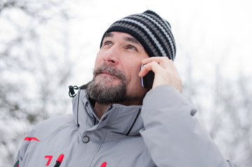 Man talking on the phone in the park