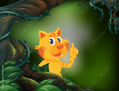 A tiger beside a big tree in the rainforest