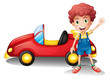 A young boy in front of a red car