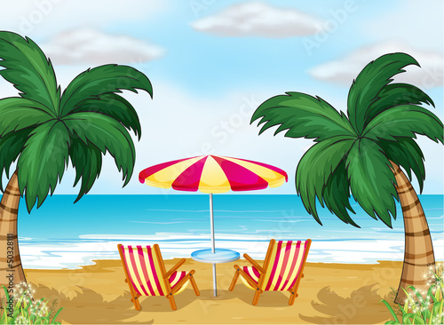 A view of the beach with a beach umbrella and chairs