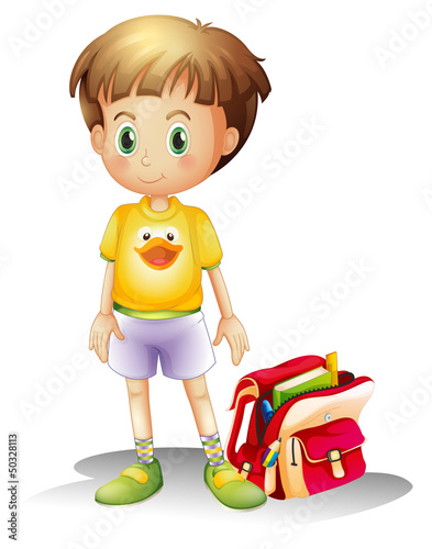 A young boy with his school bag
