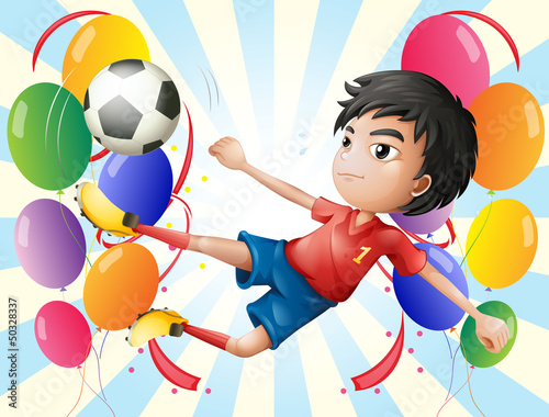 A soccer player with balloons