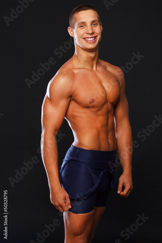 Well looking smiling man in blue shorts