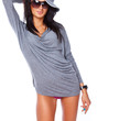 Self confident brunette in hat and short grey dress