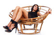 Stunning woman is lying on chair