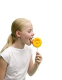 Young girl eating  flower shaped lollipop