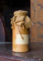 Tagged bottle ceramic bottle close sackcloth