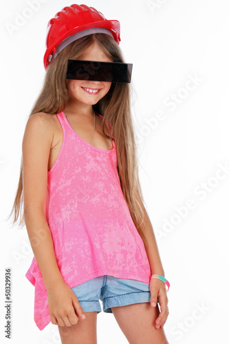 Little shy girl in hardhat and modern glasses