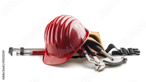 isolated red hard hat with tools on white frontal