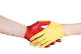 red and yellow hand handshaking