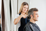 Female Hairdresser Cutting Client's Hair