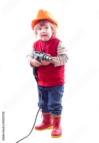 baby in hardhat with drill.
